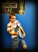 boy with a Titanic book in the autism resource center