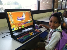 young girl at early literacy station computer
