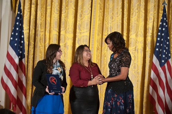 Mexic-Arte Museum coordinator and student awardee stand with First Lady Michelle Obama.