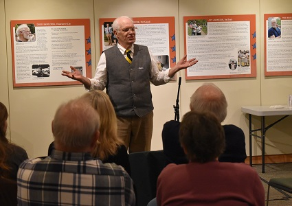 Vietnam Veteran Bill Hinderer hosts a story slam during a night of storytelling at the Maine Historical Society.