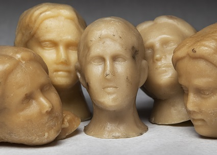 Wax ex-voto heads from Ann Hamilton's installation, Offering.