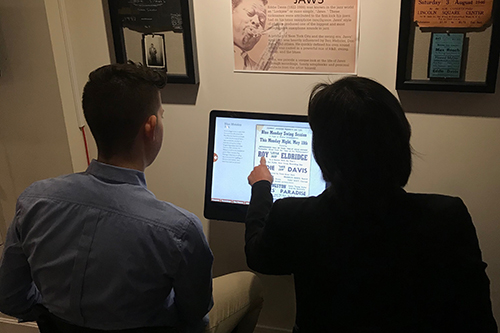 Visitors using a kiosk at the museum