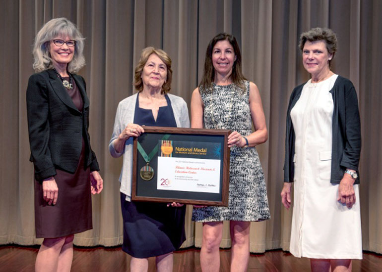 2017 National Medal recipient on stage with IMLS director and guest speaker