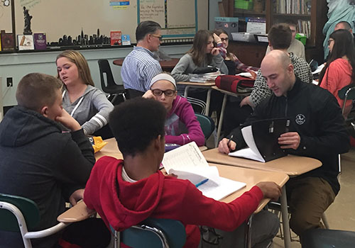 Eastlake Middle School students and police officers work together to combine their written poetry