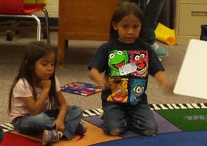 Children participate in an interactive story time at Farmington Public Library in Farmington, NM