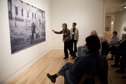 Individuals participating in gallery discussion