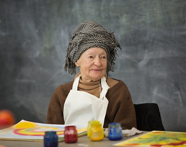 A woman participates in an art-making class at the Frye Art Museum as part of the Creative Aging program
