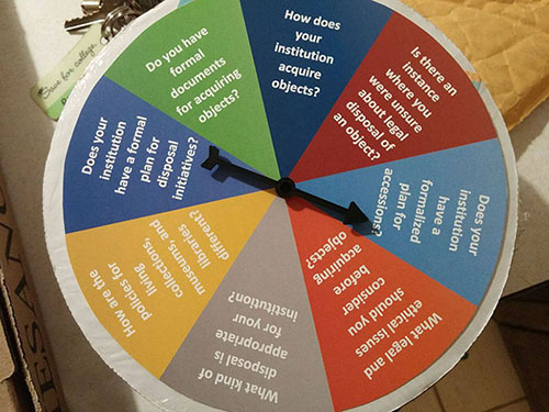 Color coded spinning Cardboard wheel