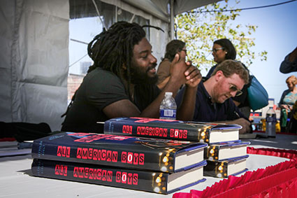 All American Boys authors Jason Reynolds and Brendan Kiely at an author tour event in 2016.