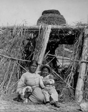Caption: Carolina Leto and son sitting under granary basket, San Ignacio, San Diego County, April 9, 1904. Photo was digitized and made web-accessible through a 2010 IMLS grant. Image courtesy of San Diego History Center.