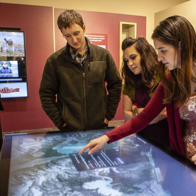 "Visitors use the interactive map at the Sealaska Heritage Institute's exhibit ""Our Grandparents' Names on the Land"". (Photo courtesy of Sealaska Heritage Institute)"