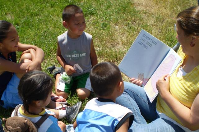 Children sitting at a library outreach reading circle