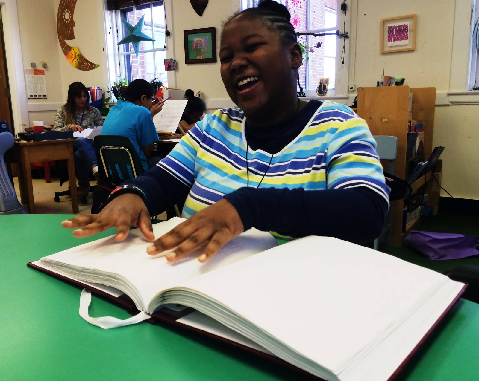 maryland library visitor reads Braille book