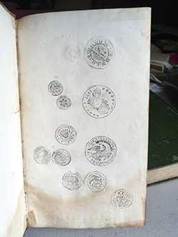 The rubbings of the coins was found in a book of Greek Grammar