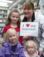 "Utah State Library bookmobile patrons with ""I love my bookmobile"" sign"